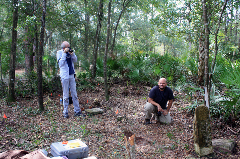 James Davidson and I documenting Rosewood's African American cemetery, make possible because of the Rosewood Heritage Project's use of new heritage (Gonzalez-Tennant 2013).